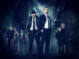 (L-R) Series stars Robin Lord Taylor as Oswald Cobblepot/The Penguin, Jada Pinkett Smith as Fish Mooney and Cory Michael Smith as Edward Nygma/future Riddler; guest star Clare Foley as Ivy Pepper/future Poison Ivy; and series stars Donal Logue as Detective Harvey Bullock, Ben McKenzie as Detective James Gordon, Camren Bicondova (above, on fire escape) as Selina Kyle/future Catwoman, David Mazouz as Bruce Wayne and Sean Pertwee as Alfred Pennyworth in Warner Bros. Television's Gotham, which is based on the characters from DC Comics. The series will air Mondays at 8/7c on FOX this fall. (Photo Credit: © Warner Bros. Entertainment Inc. All Rights Reserved.)